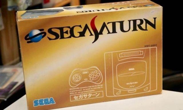The original Japanese Sega Saturn in a golden box