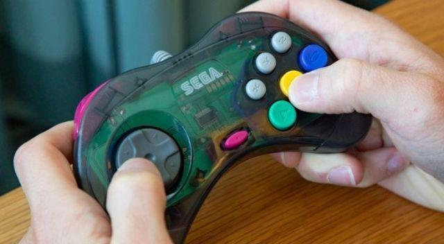 Someone holding a Sega Saturn controller