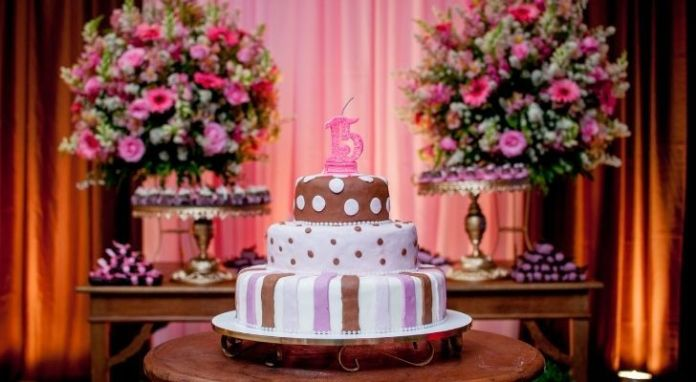 A girls 15th birthday party with a big birthday cake