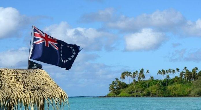 Cook Islands flag blowing in the gentle sea breeze