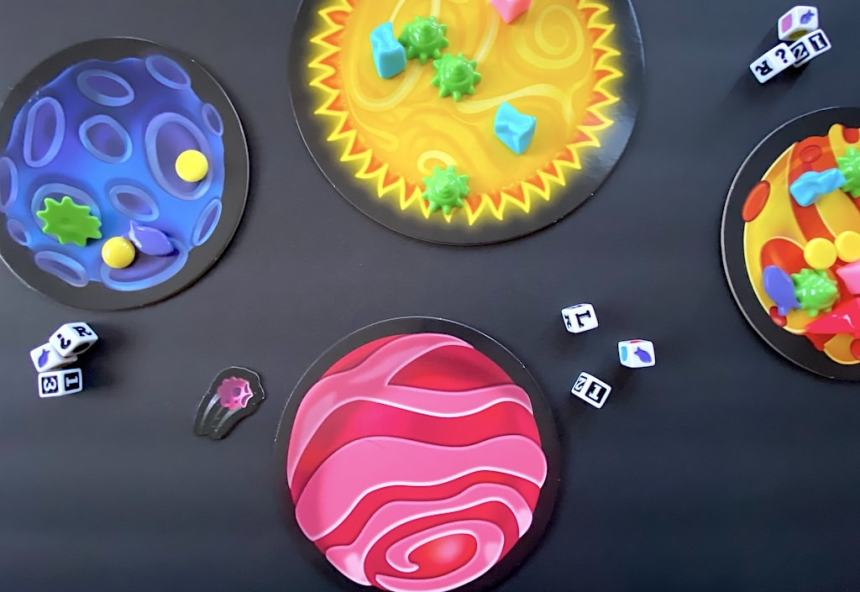 Astro Trash game: three planets and the sun. Two planets are covered in plastic trash, and one is clean