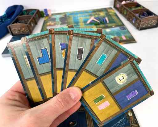 Hand of cards in Atheneum: Mystic Library