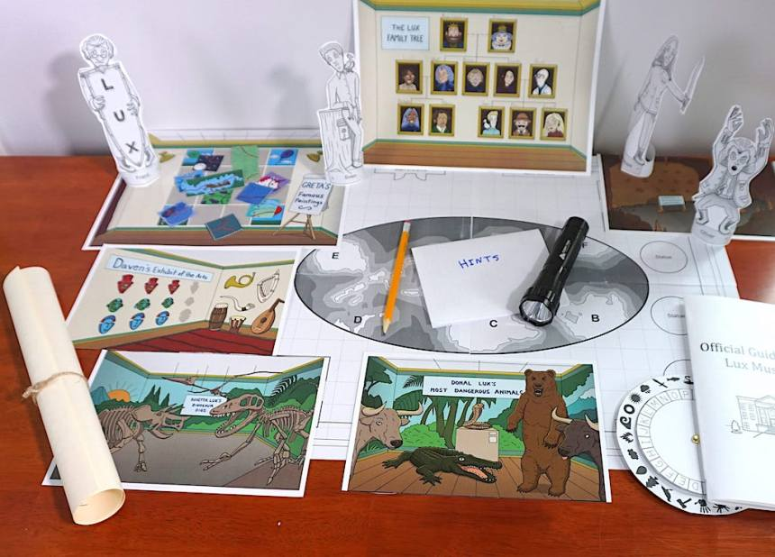 Clever Kids Mysteries components: paper statues, illustrated photos of museum exhibits, map, flashlight, pencil, decoder wheel
