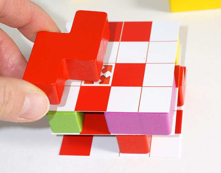 Placing a red block on a new floor