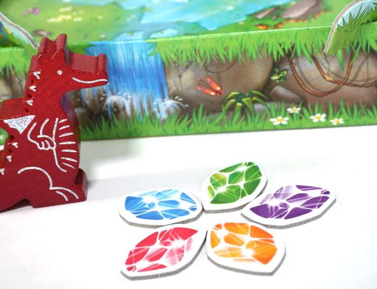 Dragon dad and colored tokens from Dragon's Breath: red, blue, green, purple, yellow.