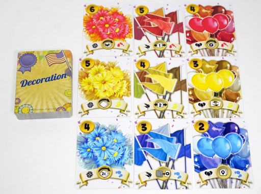 Everyone Loves a Parade decoration cards arranged in three rows (red, yellow, blue) and three columns (flowers, flags, balloons)