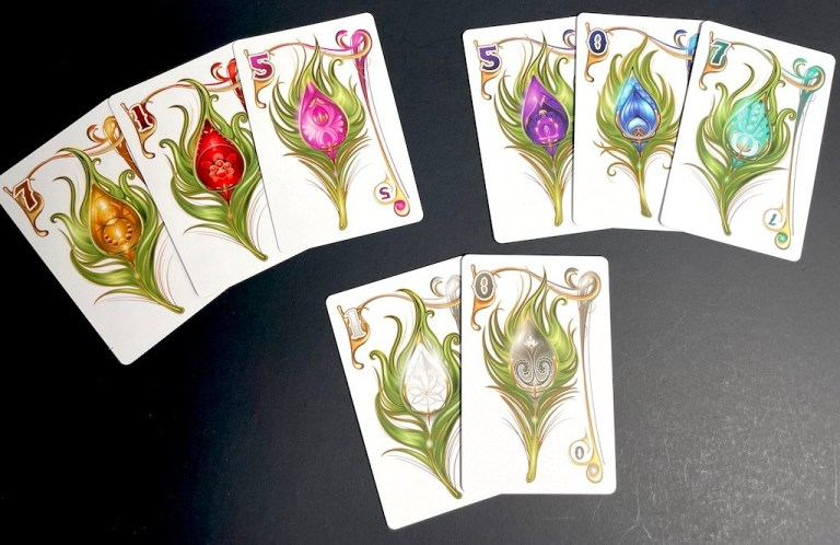 Peacock feather cards in similar colors