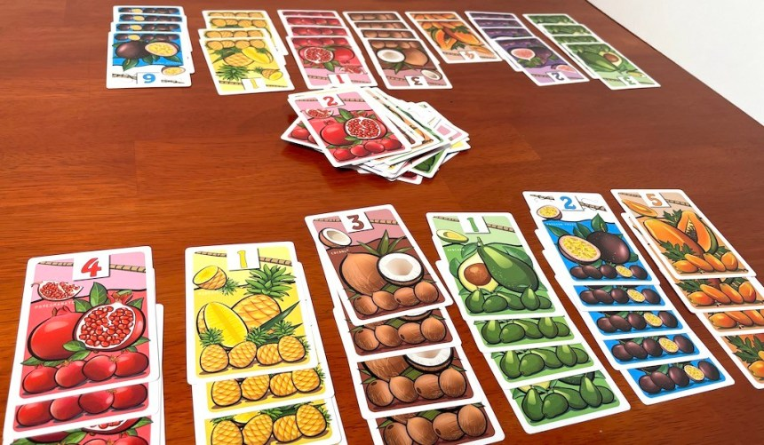 Two sets of Fruit Passion cards, facing each other with a discard pile in between