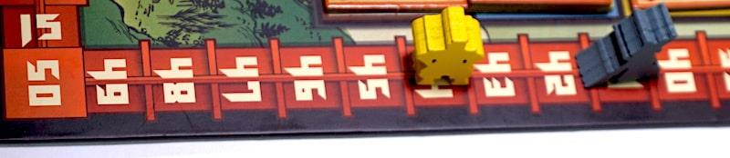 Yellow and gray daimyo meeples on the scoretrack