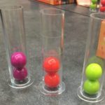 3 test tubes, 2 colored balls in each