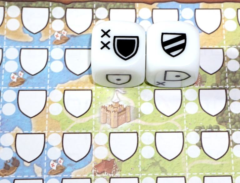 Black shield and two stripe shield placed together on the Kingdomino Duel player sheet