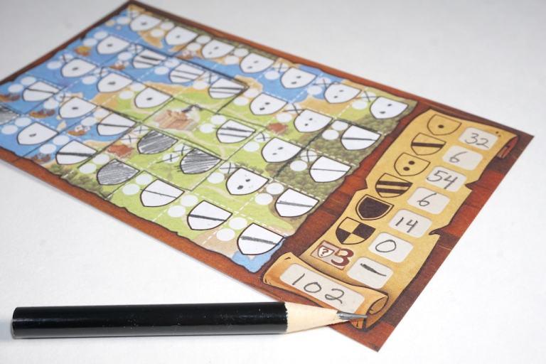 Scoring a Kingdomino Duel player sheet. 32 + 6 + 54 + 6 + 14 = 102