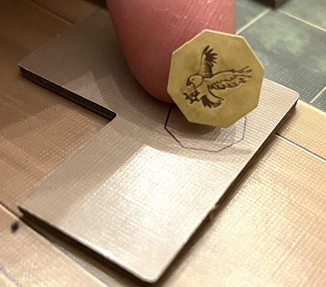 Eagle sticker being put on a tile back
