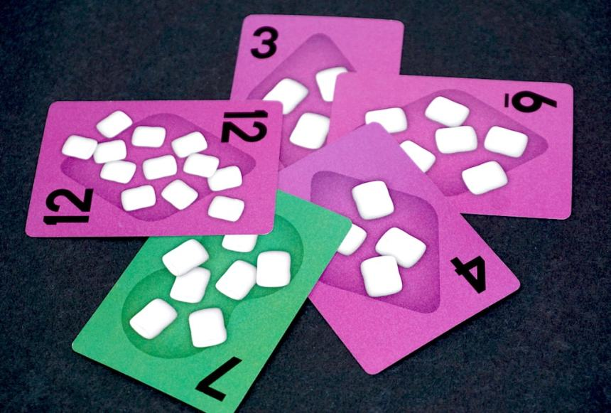 Five cards: purple 3, 6, 4, and 12; green 7.