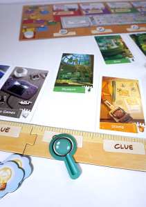 Focus token in center of player board. Green Location card moved from focus location to center board