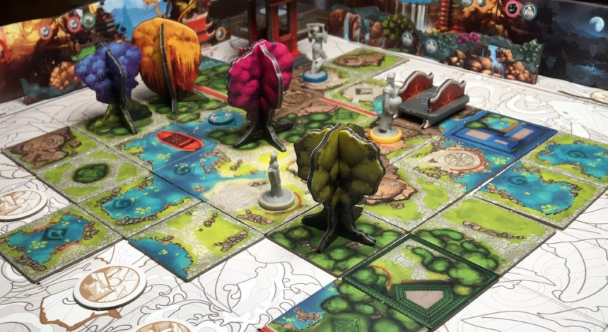 Trees and gray character minis set out on the Tang Garden board.