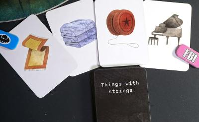 rule: Things with strings. Object cards: rug with fringe, towel, yo-yo, piano.