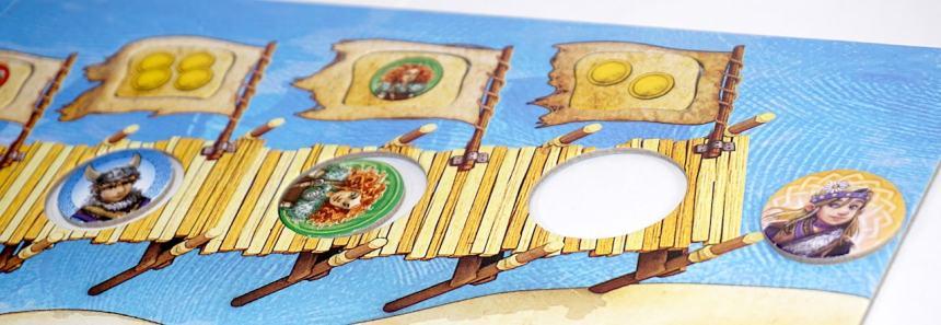Blue Viking under four coins flag, green Viking under green flag, yellow Viking in water at far right
