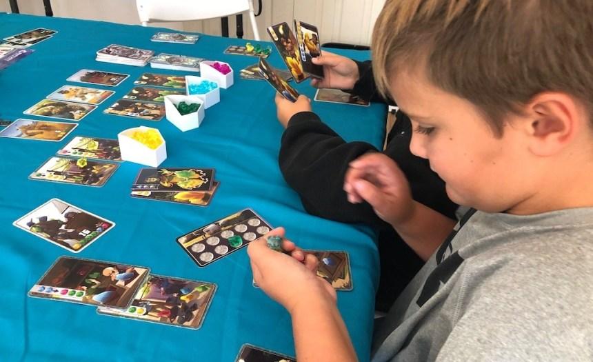 Boys playing Century: Golem Edition