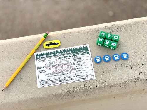 Road Trip Dice Game scoresheet, pencil, station wagon token, 6 dice, 4 gas tokens