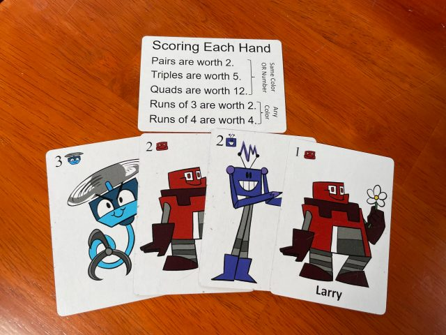 Scoring each hand: Pairs are worth 2, Triples are worth 5, Quads are worth 12. Runs of 3 are worth 2. Runs of 4 are worth 4.
