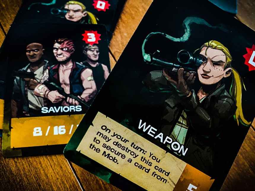 Andrea/Weapon card: On your turn, you may destroy this card to secure a card from the Mob.
