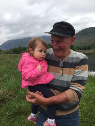 Boat captain holding girl