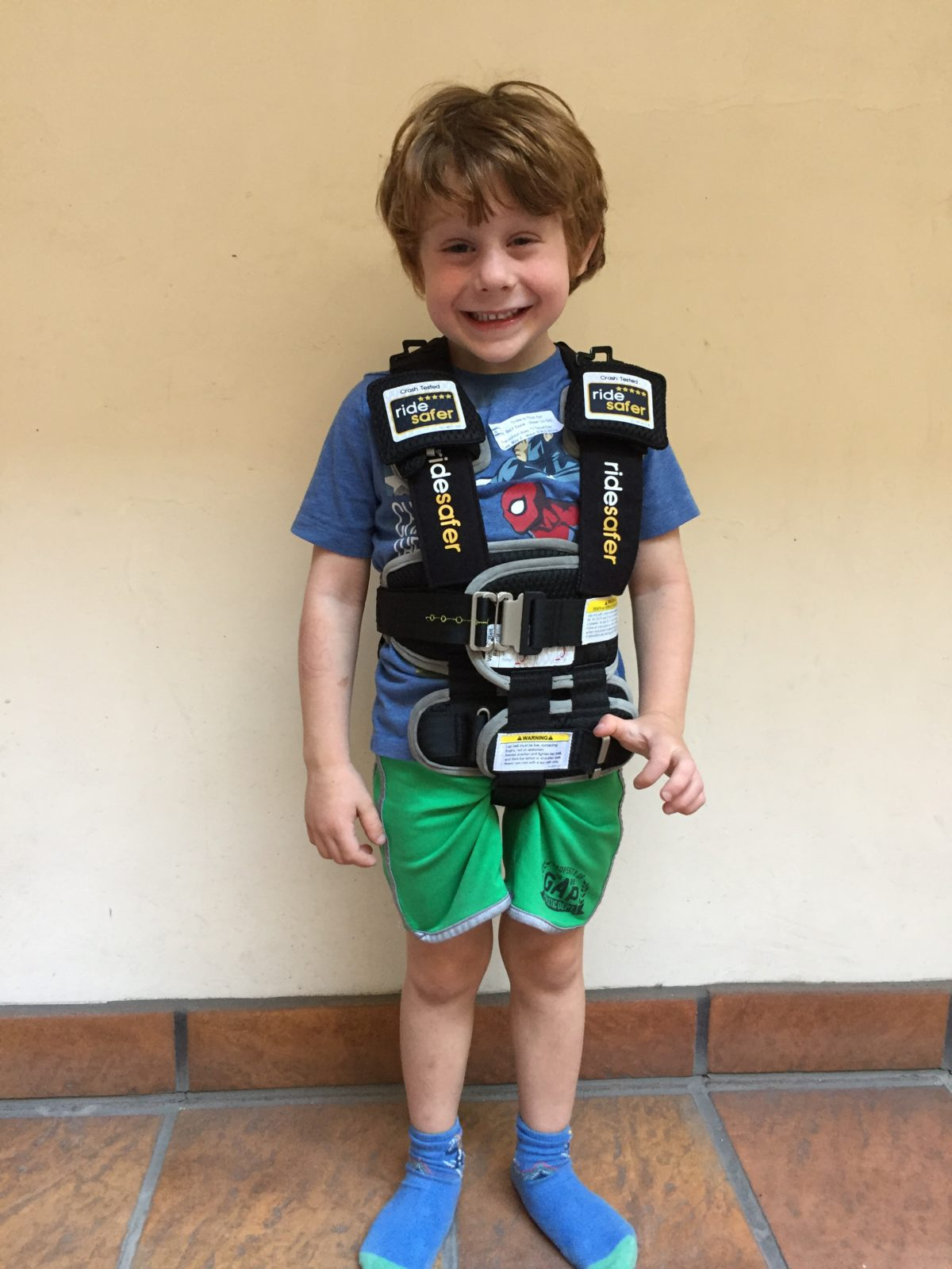 """Ride Safer travel vest on our test model at 41"""" and 40lbs. This picture shows the optional crotch strap in use."""