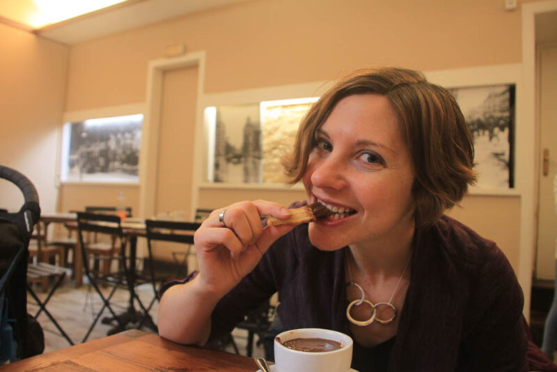 eating churros con chocolate in Spain