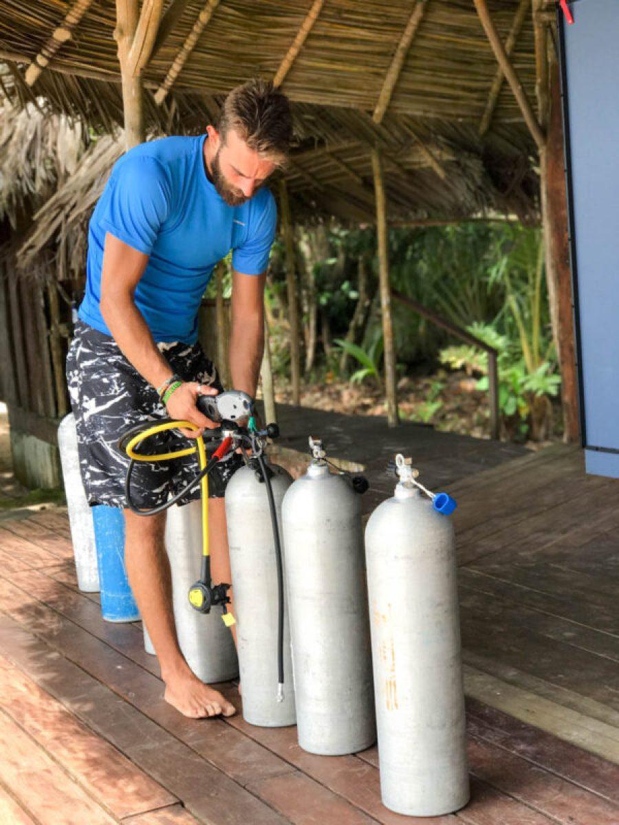 Prepping for a dive from the Zapatillas Dive Center at Al Natural, Bocas del Toro all-inclusive