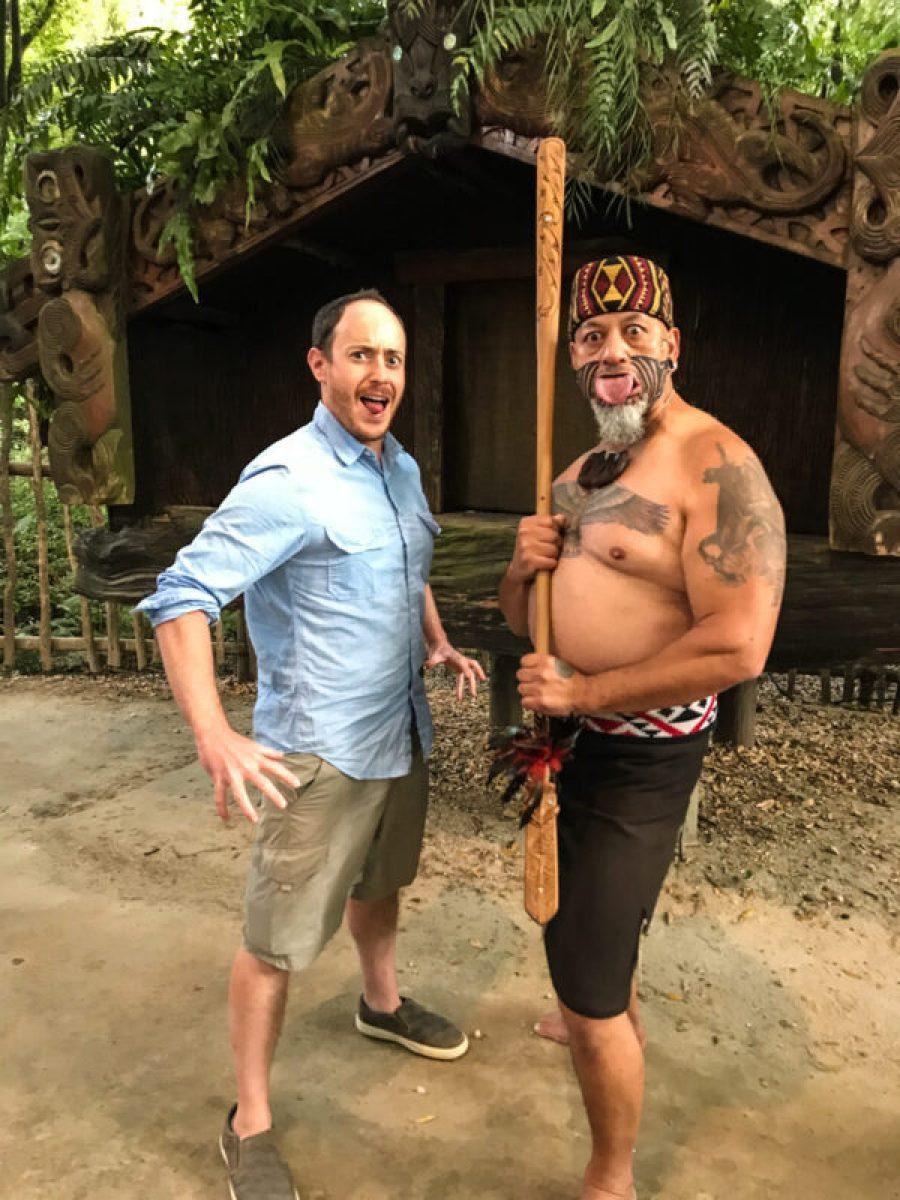 two men demonstrating haka at Tamaki Maori Village in Rotorua, New Zealand