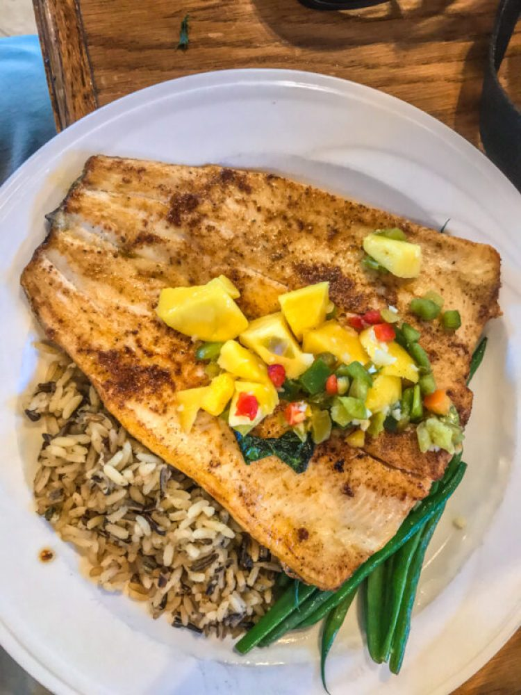 Fish and rice entree on a white plate at the Chisos Mountain Lodge restaurant