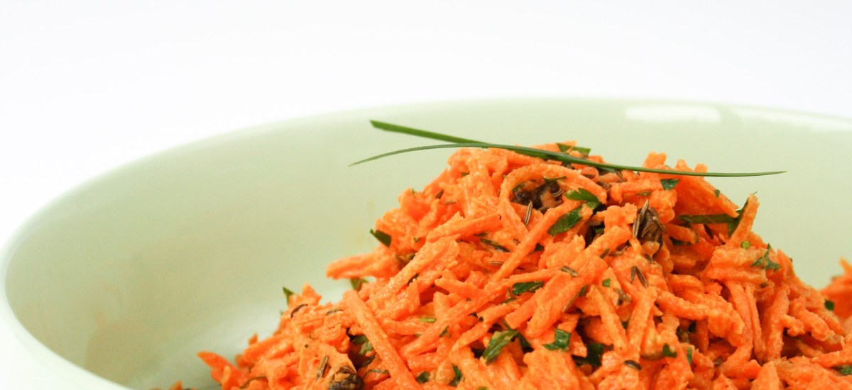 Carrot salad with currants and toasted caraway seeds