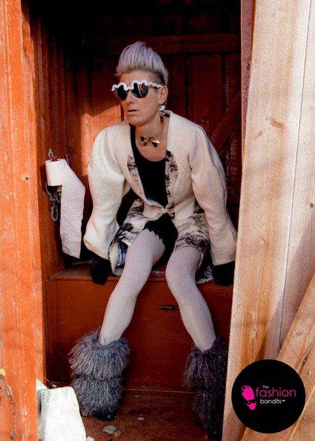 The Fashion Bandits Benedikte St.Pierre on the toilet in the outhouse...