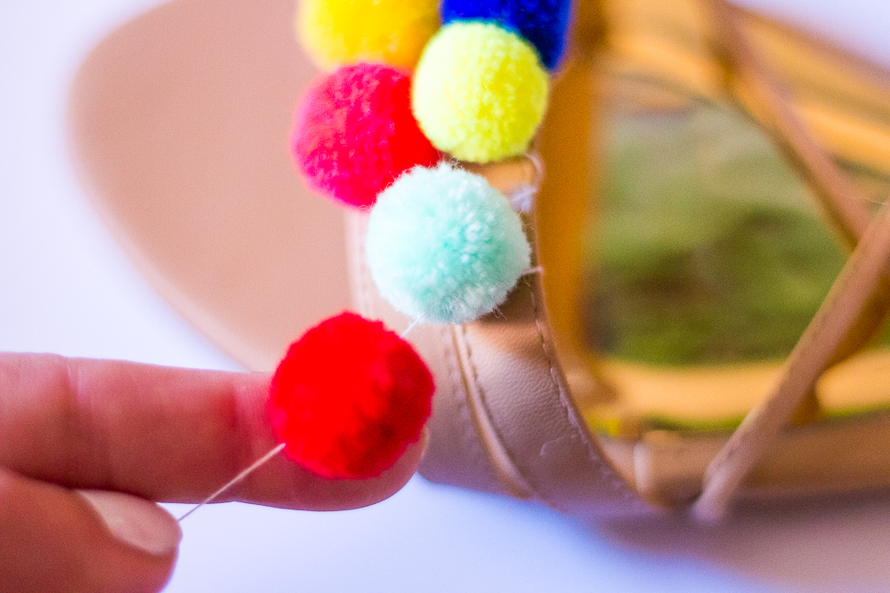Continue this process and add as many pom poms as you like!