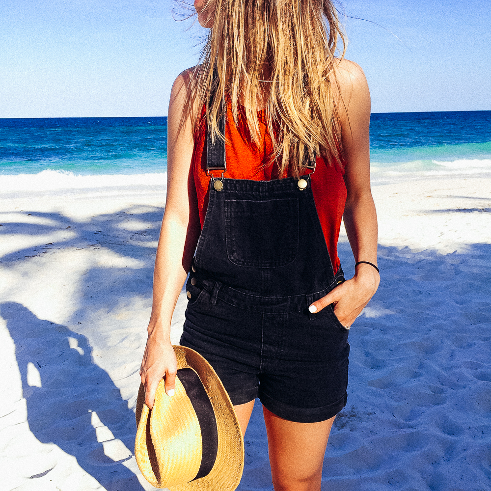 Black overalls on the beach