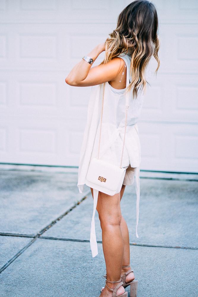 Sleeveless white blazer