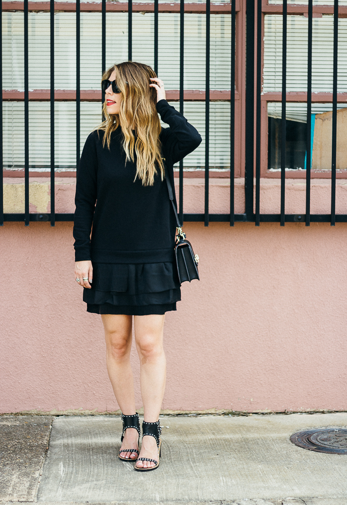 black sweatshirt dress with ruffles and studded sandals