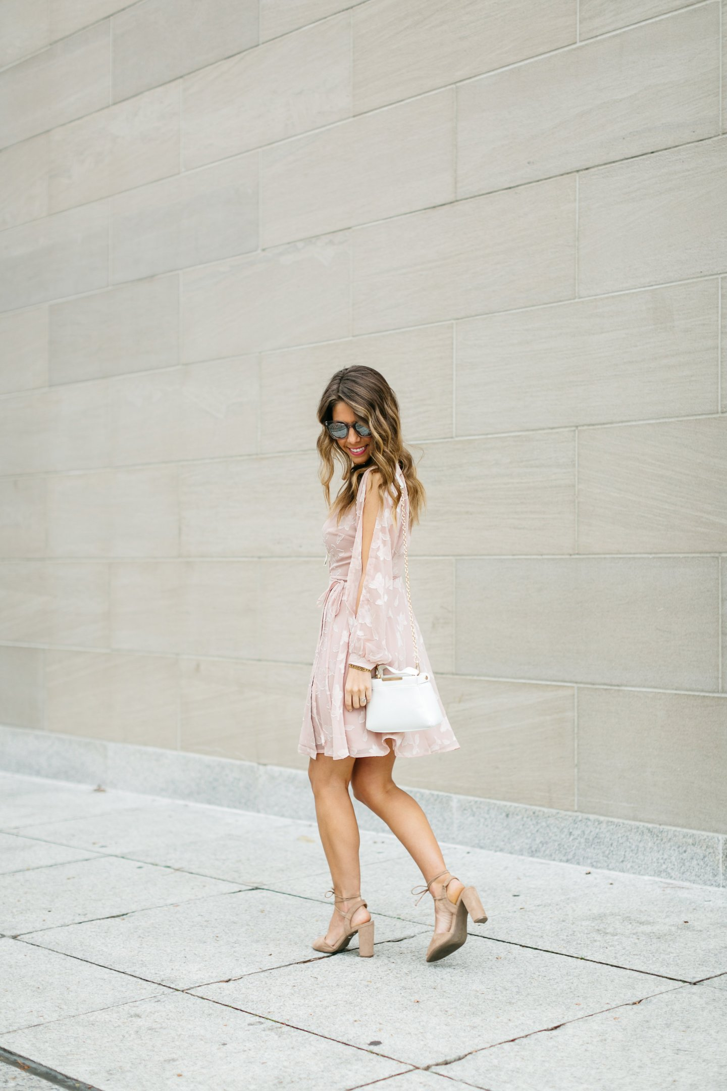 fashion blogger in pale pink wrap dress
