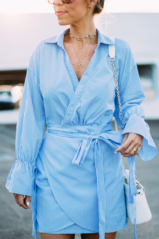 blue pinstripe wrap dress with statement sleeves