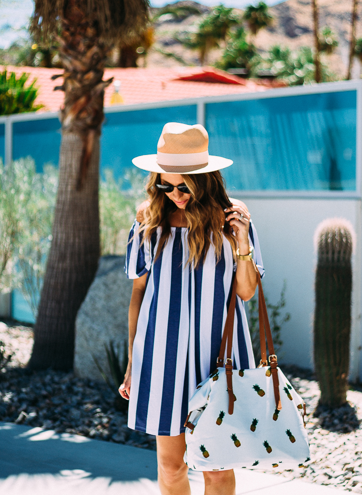 striped dress and pineapple bag