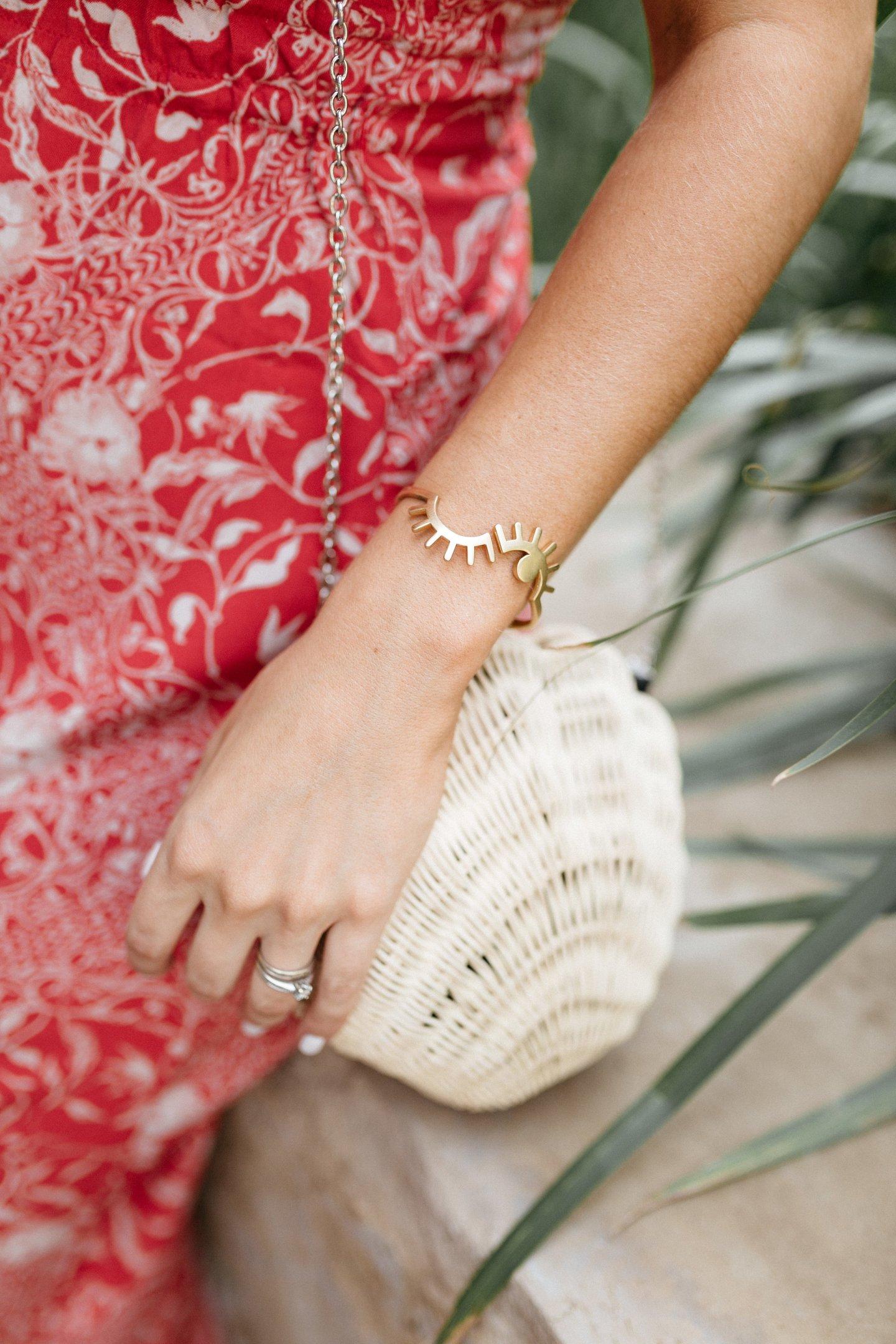 gold cuff and sea shell purse