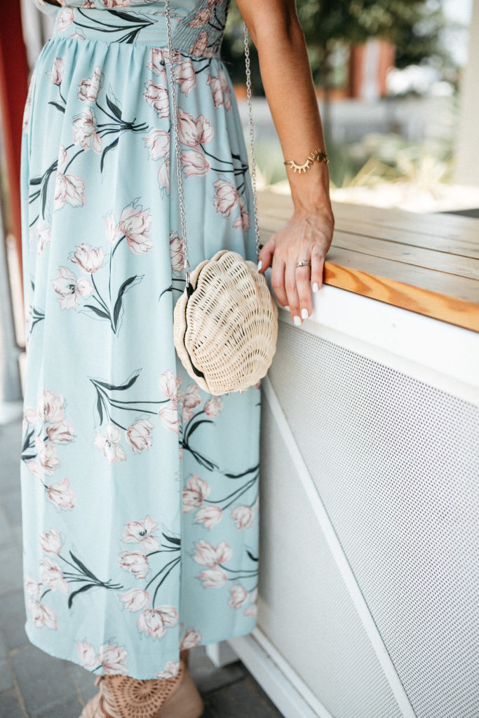 floral dress with shell clutch
