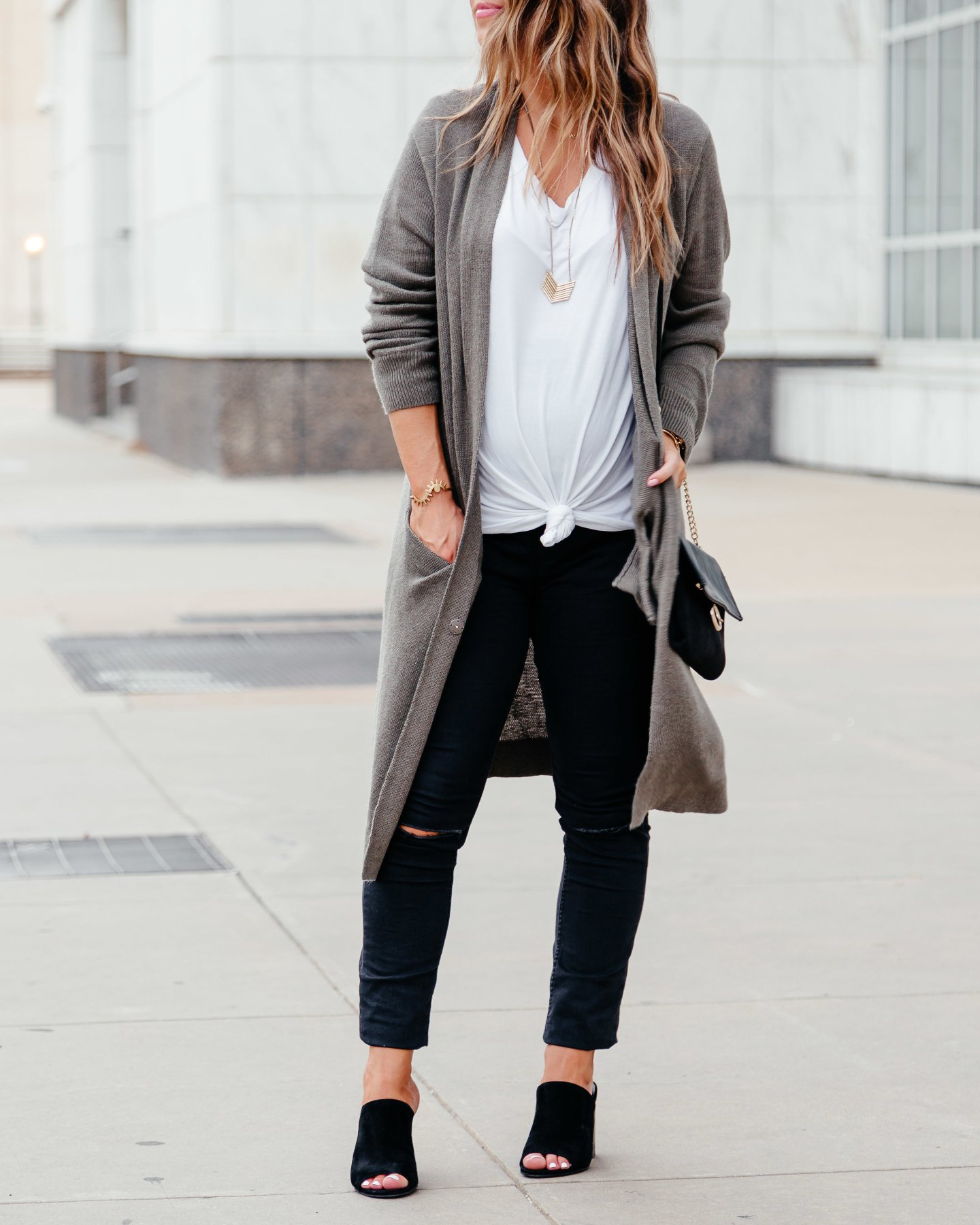 white tee with olive cardigan and jeans