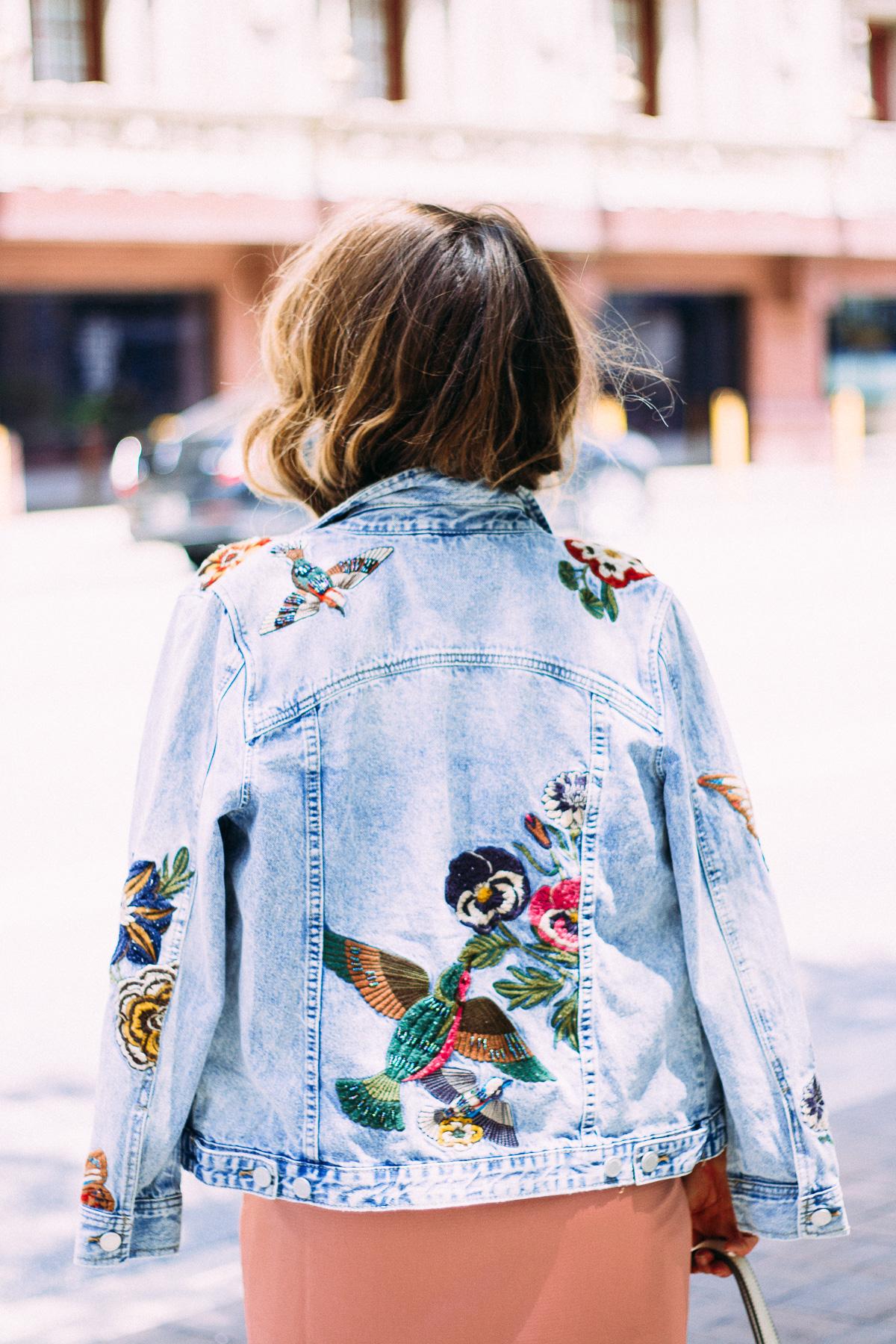 embroidered denim jacket over pink slip dress