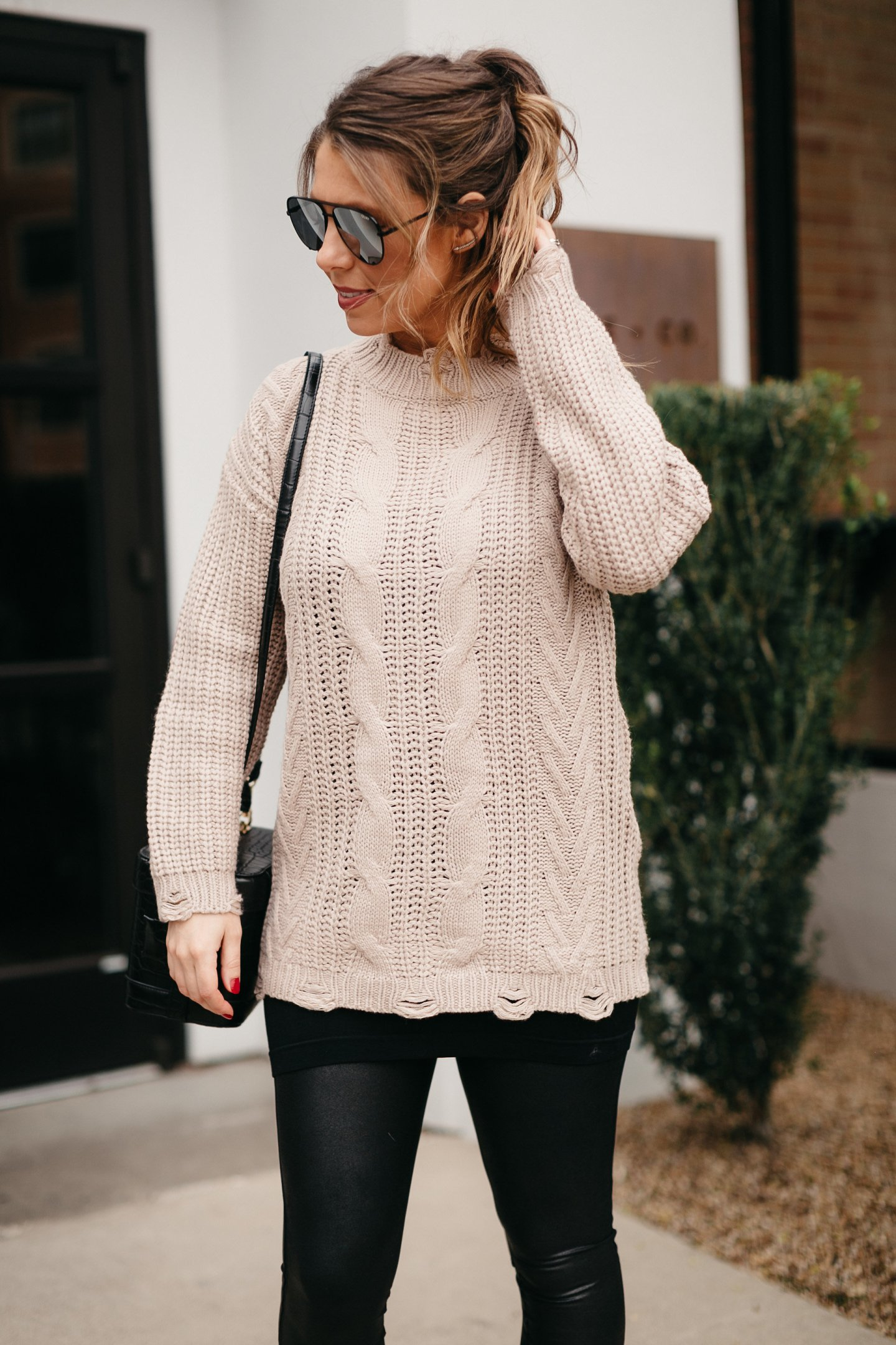 oversized sweater with black tassel earrings