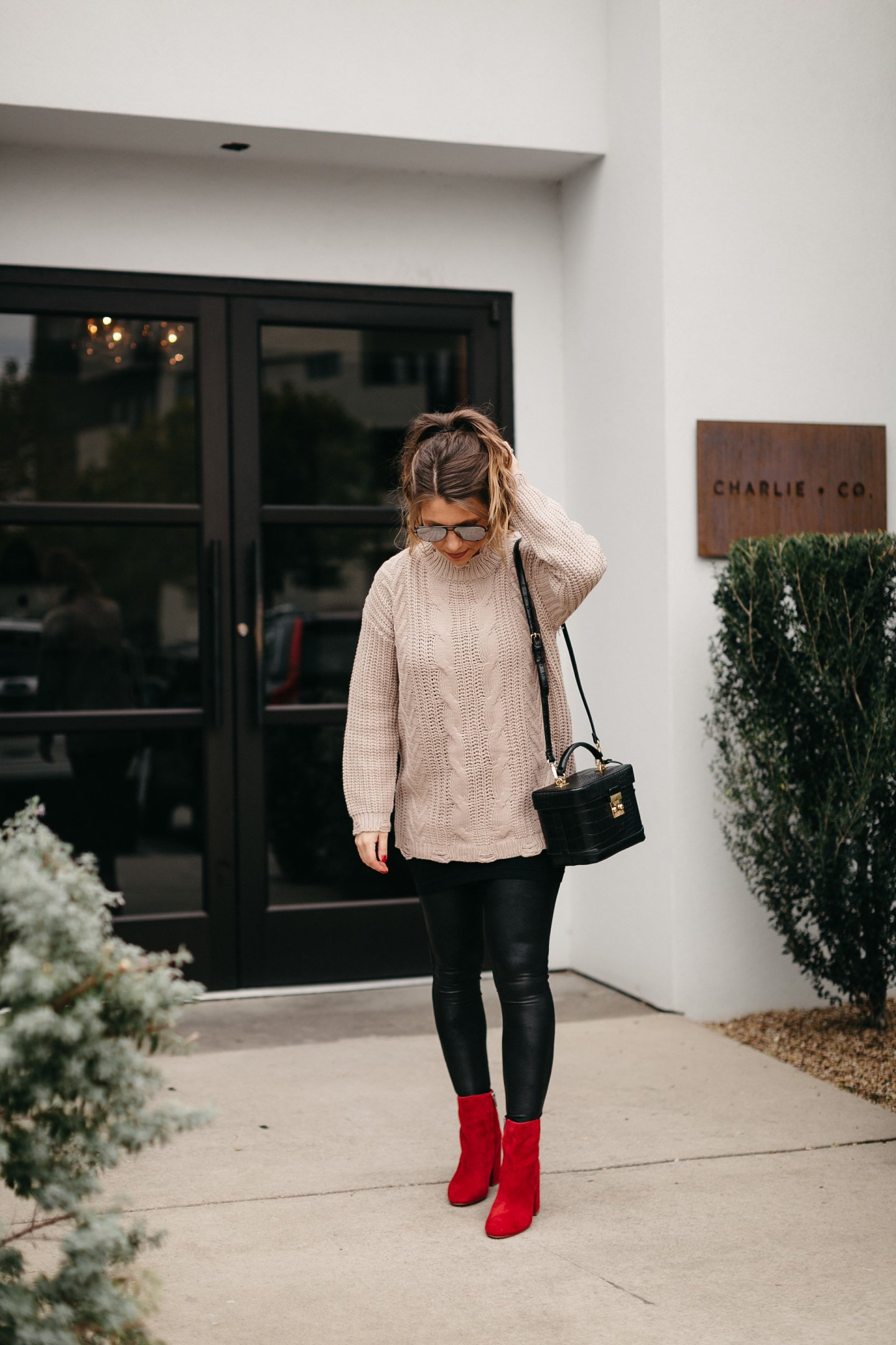 pom beanie cable knit sweater faux leather leggings