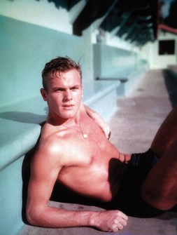 Tab Hunter dons a speedo as he poses for a shirtless picture.