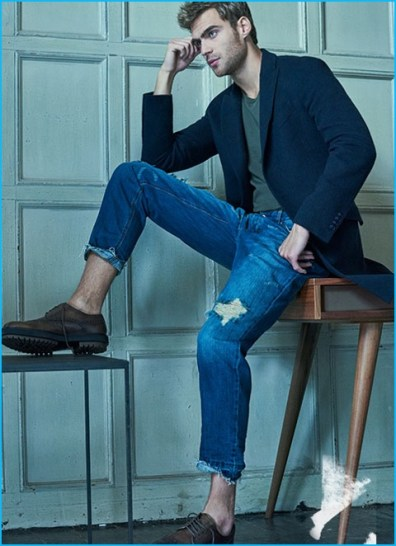George Alsford channels smart style, wearing Ami denim jeans with a single-breasted Etro coat, Maison Margiela t-shirt, and Tod's shoes.