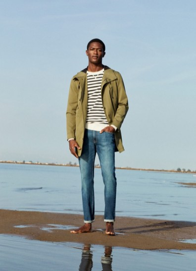 Taking to the beach, Hamid Onifade models the latest men's clothing from Mango.